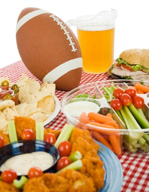 Table set with snack foods for a Super Bowl party. (focus on football)