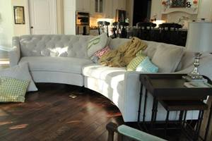 Couch with throw pillows and hardwood floor