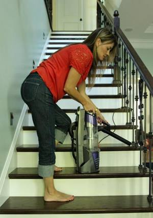 Woman vacuuming hard surface steps