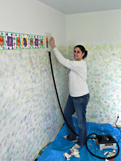 Author applying wallpaper