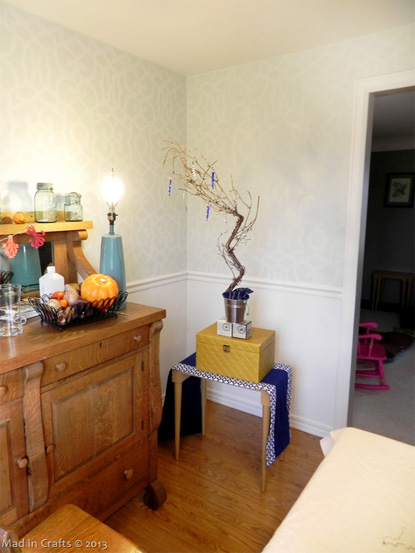 Author's dining room with ornaments set up and lighted for photography